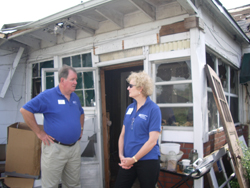 Linda Valentine talking with Doug Macdonald at a work site.
