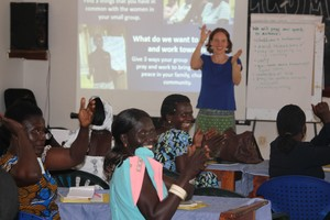 Nancy facilitating discussion with women leaders about problems in their communities.