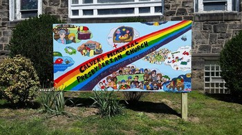 """Art Mural/outdoor sign created by neighborhood kids at Calvert Memorial Presbyterian Church's after-school program — with images of life in the church and the children who helped create it."""