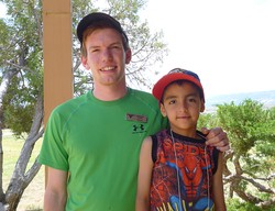 Cameron Newell with Eric Rivas, a son of Joey Rivas, Ghost Ranch's executive chef.