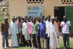 :  RELUFA coordinator Jeff Bamenjo (far left) with communities of Gozemey, North Cameroon, in front of their granary.