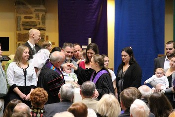 Emily Chudy welcomes new children and families into life at Central Presbyterian through the sacrament of baptism.