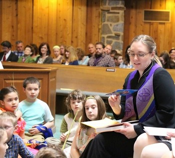 "Chudy shares ""fish boxes"" story and the One Great Hour of Sharing with children on Palm Sunday."