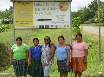 Cynthia White, (center) visits with the Marigold Women's Project in the Toledo District of Belize, one of the SDOP funded projects in the region.