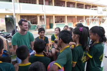 Daniel Pappas with youth in Peru.
