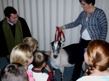 People with goat in church