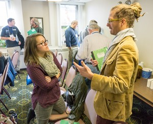 Jane Larson, a PC(USA) seminarian at Pittsburgh Theological Seminary, and the Rev. Chad Collins, pastor at Valley View Presbyterian Church in Pittsburgh, talk about current issues at the 2015 IPMN gathering.