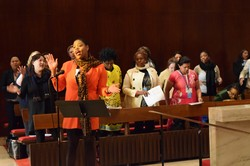 LaThelma Armstrong, one of the eleven young women who attended the Commission on the Status of Women through scholarship support from the Women's Leadership Development & Young Women's Ministries Office, leads attendees during a worship service.