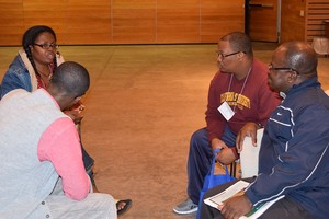 Tega Swann, Samuel Yenn Batah, Stephen Robertson and Benjamin Kwasi Aye-Addo gather together for small group discussion during the 37th annual Racial Ethnic & New Immigrant Seminarians Conference.