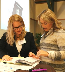 World Mission staff members Ellen Sherby (left) and Rachel Yates (right) lead a conference session.