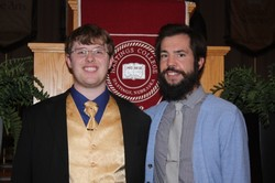 Logan Ellis (left) and Rev. Damen Heitmann, chaplain to Hastings College, in French Memorial Chapel.