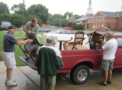 Furniture ministry volunteers from First Presbyterian Church of Burlington unload furniture at a client's home.