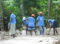 Work crews in Haiti clear rubble from a home outside of Léogâne