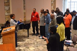 African American clergywoman leads worship