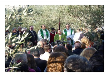Pastors Michel Sabbah and Abuna Shomali conduct a communion service for Christians non-violently protesting the construction of Israel's separation barrier in an area of the Cremisan Valley that will cut a monastery off from a convent and school the monks and nuns jointly operate.