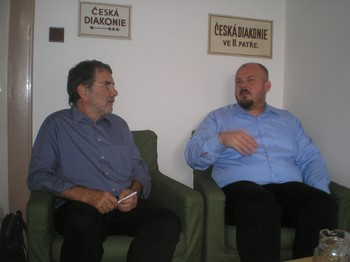 Burkhard Paetzold (left), the PC(USA)'s regional liaison for central Europe, discusses the diaconal work of the Evangelical Church of Czech Brethren with David Sourek of the ECCB.