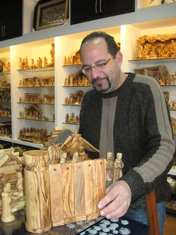 Bethlehem souvenir-shop owner Jack Giacaman displays nativity scenes, complete with Israel's Separation Barrier/Wall.