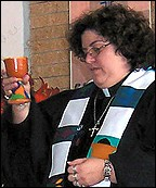 Marissa Galvan-Valle in vestments holding a chalice