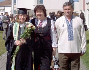Iryna Sychyk with her parents at graduation.