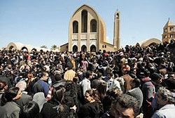 Some of the thousands of Egyptians who gathered to pay respects to Pope Shenouda. Instead of lying in state, his body was seated on a wooden throne.