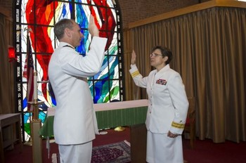 U.S. Navy Adm. Jonathan Greenert gives Rear Adm. Margaret Kibben the oath of office and promotes her to the rank of rear admiral and to Chief of Chaplains, succeeding Rear Adm. Mark Tidd who is retiring from naval service.
