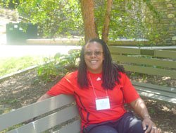 The Rev. Flo Watkins sitting on a bench.