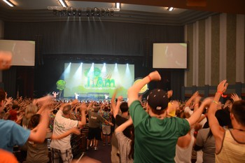 Energizers get the Youth Triennium crowd on their feet during opening worship.