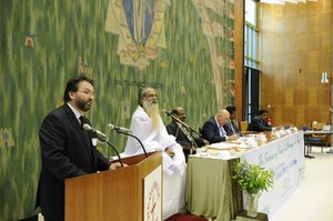 Fr Daniel Buda (left) speaking at the Global Energy Parliament in Geneva.