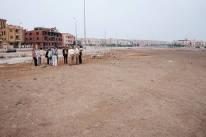 A group meets to pray on a plot of land where their future church will be built in the city of Sheikh Zaid, Egypt. The Egyptian government donated 14 parcels of land to the Evangelical Presbyterian Church in Egypt (EPCE) for construction of new churches.