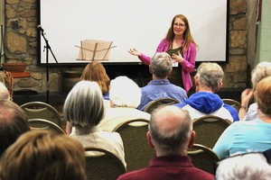 Rebecca Barnes, associate with Environmental Ministries, leads conference attendees through the opening worship service of the 2015 Presbyterian Earth Care Conference.