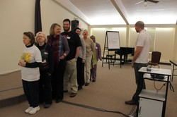 Bryce Wiebe (right) manager of Special Offerings, conducts an exercise with attendees of the Special Offerings Leader Support Network Ambassadors Training.
