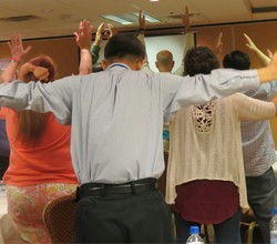 Conference goers felt Christ was with them as they participated in a body prayer.