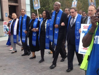 Left to right, Rev. Sung Yeon Choimorrow, Rev. Michael Livingston, Rev. Andrea Alexander, Rev. Sekinah Hamlin, Rev. Dr. J. Herbert Nelson, Rev. Dr. Ken Brooker Langston, Rabbi Jason Kimelman-Block, marched asking the Pope to acknowledge the plight of striking low-wage federal contract workers.