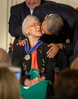 President Barack Obama kisses former NASA mathematician Katherine Johnson after presenting her with the Presidential Medal of Freedom, Tuesday, Nov. 24, 2015.