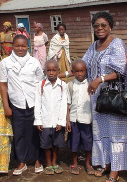 The Rev. Berthe Kalombo Nzeba with a rape survivor and her twin sons.