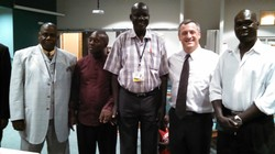 Pastors gather at Orangewood Presbyterian Church in Phoenix, Arizona to hear from Peacemaker, the Rev. James Ninrew from South Sudan (center) in 2014.