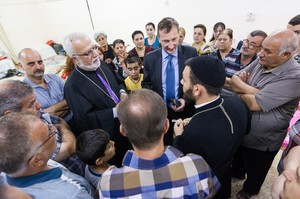 Peter Prove with displaced people at the parish hall of Serseng near Dohuk, Iraq.