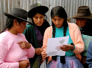 Artisans from the group Tupac Yupanki, which is supported by Partners for Just Trade, review an order.