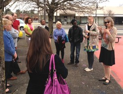 Jenny Holmes with Ecumenical Ministries of Oregon speaks with the Presbyterian Hunger Program Advisory Committee on the site of a future farmers market in the Rockwood community.