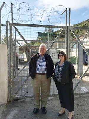 PC(USA) Moderator Heath Rada and Presbyterian Disaster Assistance Coordinator the Rev. Dr. Laurie Kraus stand outside of a detention camp on Samos Island, Greece. Several hundred refugees are interned there.