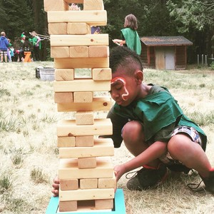 A camper plays a game of giant Jenga at Calvin Crest's 'Sherwood Forest' camp experience.
