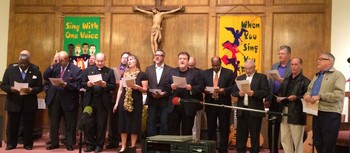 group of clergy lead congregation in song