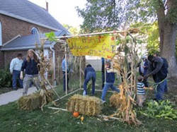 Children of Abraham members gather to build a sukkah and celebrate at Temple Beth El