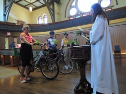 Officiant Ann Russell presides over the sixth annual Blessing of the Bikes at Toronto's Trinity-St. Paul's United Church on June 7, 2015.