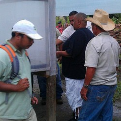 SDOP National Committee members visit with representatives  of the Trio Farmers and Seine Bight Village projects in Belize.