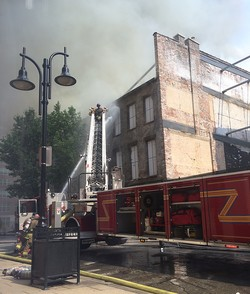 Firefighters battle the July 6 blaze in Louisville's historic 'Whiskey Row' outside the Washington Street entrance to the PC(USA) headquarters.