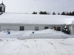 Windham Presbyterian Church in New Hampshire is blanketed by last winter's record snow.