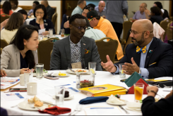 Sera Chung and Samuel Yenn-Batah speak with presenter Victor Aloyo Jr. (right) at the Presbyterian Intercultural Luncheon.
