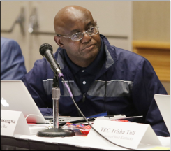Bobby Musengwa listens during a  meeting of the Social Justice Issues Committee.