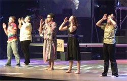 Youth perform on the stage of the 2010 Presbyterian Youth Triennium at Purdue University.